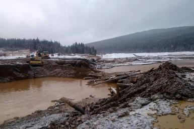 The dam's collapse unleashed a torrent of icy and muddy water, which engulfed the workers' huts