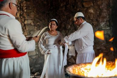 Iraqi Kurd Faiza Fouad takes part in a ritual ceremony in an ancient and ruined temple as she joins the millennia-old Zoroastrian religion