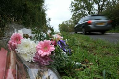 Tributes lie on the roadside near RAF Croughton in Northamptonshire, central England on October 10, 2019, at the spot where Harry Dunn was killed as he travelled along the B4031 on August 27