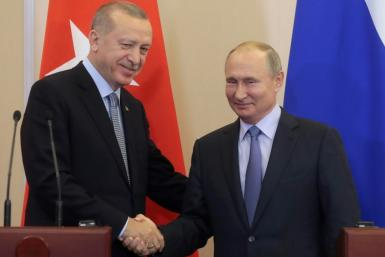 "Turkey's Recep Tayyip Erdogan (L) hailed ""a historic agreement"" on dealing with the Kurds in Syria following talks with Russia's Vladimir Putin at the Russian Black Sea resort of Sochi"