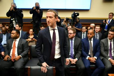 """Facebook Chairman and CEO Mark Zuckerberg arrives to testify before the House Financial Services Committee on """"An Examination of Facebook and Its Impact on the Financial Services and Housing Sectors"""""""