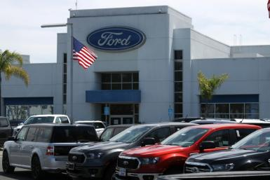 Ford reported lower quarter and slashed its full-year forecast, citing increased incentive spending in North America and lower sales in China