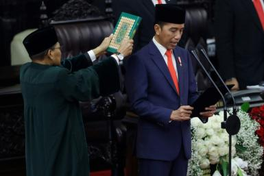 Indonesia's President Joko Widodo (R) was sworn in for a second five-year term at parliament in Jakarta on October 20, 2019