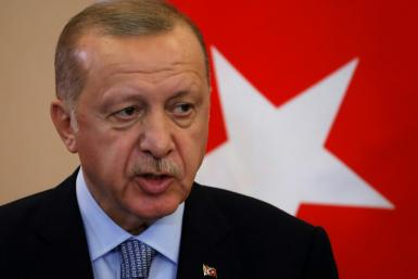 "Turkish President Recep Tayyip Erdogan says he will ""clear terrorists"" from the border between Turkey and northern Syria if Syrian Kurdish militia don't withdraw by Tuesday"