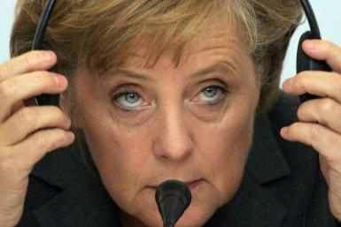 German Chancellor Angela Merkel says if the Berlin hadn't fallen, she would have driving around the US listening to Bruce Springsteen