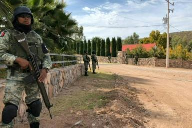 Mexico's National Guard patrolled near the La Mora ranch where the massacre victims lived