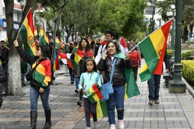People take to the streets of La Paz to celebrate the resignation of Bolivian President Evo Morales on November 10, 2019