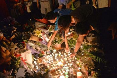Mourners light candles during a vigil at the site of a knife attack which left two children dead in Shanghai in 2018. Attacks by society outcasts against children are not uncommon in China