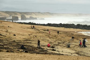 People on the beach Monday at Capbreton, southwestern France, where packages of cocaine have been found in recent days.