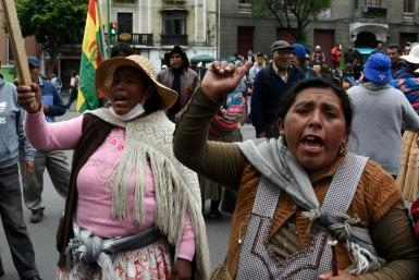 Supporters of Bolivia's ex-president Evo Morales protest in La Paz after he left for exile in Mexico