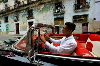 Yosbel Sosa drives tourists around Havana in a 1959 Chevy