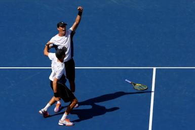 Bob Bryan (top) and Mike Bryan (bottom) celebrate their victory in the men's doubles final at the 2014 US Open