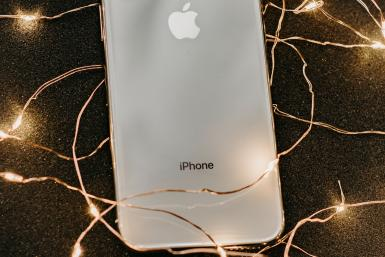 silver-iphone-x-lying-on-pre-lit-string-lights-1647976 (1)