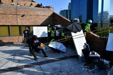 Protesters used a catapult to fire bricks at police from inside the Hong Kong Polytechnic University