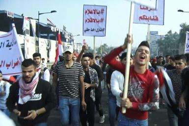 Iraqi anti-government demonstrators react to the protests that erupted in Iran after a suprise announcement to impose petrol price hikes and rationing. Reports on a trove of leaked Iranian intelligence documents drove home the depth of its influence in Ir
