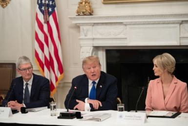 Apple CEO Tim Cook, seen here at a meeting of the American Workforce Policy Advisory Board at the White House, has reportedly worked with the president's daughter Ivanka (R) and her husband Jared Kushner to keep communication channels open