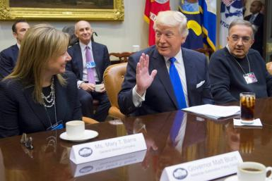 GM Chief Executive Mary Barra and the late FCA Chief Executive Sergio Marchionne, shown here with President Donald Trump at a White House meeting in January 20017, are key players in GM's lawsuit against FCA