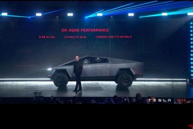 Tesla Chief Executive Elon Musk stands in front of the company's first electric pickup truck, the Cybertruck, after it was unveiled in Los Angeles