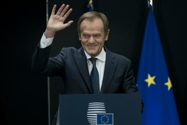 Donald Tusk was brought to the brink of tears in the brief handover ceremony
