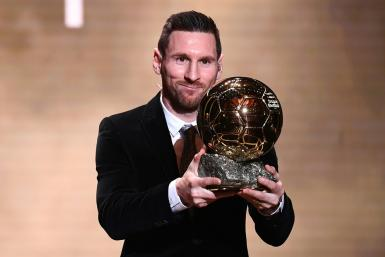 Lionel Messi happily collected his sixth Ballon d'Or in Paris on Monday