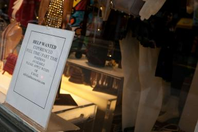 A 'help wanted' sign in the window of Add Accessories in New York City