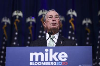 "Michael Bloomberg's financial services company said it corrected what it described as an ""oversight"" which directed users of the market information terminals to his presidential campaign website"