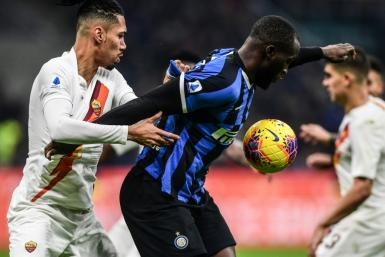 AS Roma defender Chris Smalling holds off Inter Milan forward Romelu Lukaku