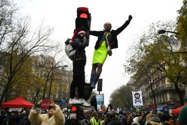 Protesters take part in a demonstration against the pension overhauls, on Place de la Nation in Paris, on December 5, 2019