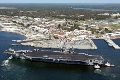 The USS John F. Kennedy is pictured in 2004 at the Naval Air Station in Pensacola, Florida, where a shooter was killed after opening fire on December 6, 2019