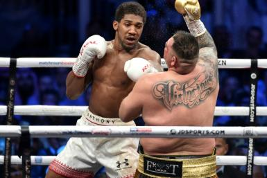 British boxer Anthony Joshua rocks Andy Ruiz on his way to regaining his world heavyweight titles