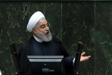 """Iran's President Hassan Rouhani presented a """"budget of resistance"""" against crippling sanctions imposed by arch-enemy the United States"""