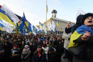 Protesters held placards with slogans such as 'No to capitulation', 'Stay away from Moscow' and 'Russian gas is a noose around our necks'