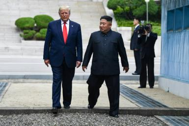 "US President Donald Trump, pictured (left) with North Korea's Kim Jong Un at the Military Demarcation Line dividing North and South Korea, said he would be ""surprised"" by hostility from Pyongyang"
