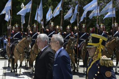Cuban President Miguel Diaz-Canel (L) takes part in a wreath-laying ceremony to pay homage to Argentine national hero General Jose de San Martin, at San Martin Square in Buenos Aires on Monday