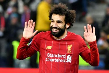 Mohamed Salah's strike from a tight angle sealed Liverpool's 2-0 win in Salzburg as they went through to the Champions League last 16