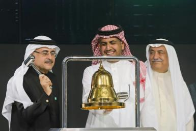 Saudi Aramco head Amin Nasser rings the bell as the oil giant's shares start trading