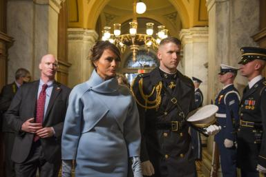Melania Trump, escorted by a U.S. Marine, arrives at the 58th Presidential Inauguration