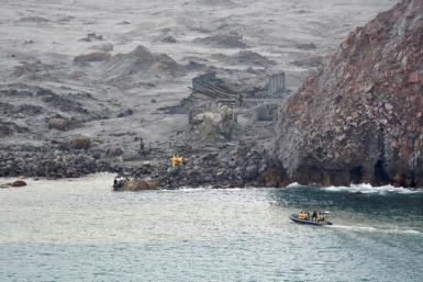 The goal of the team from the bomb disposal squad was to recover the remains of eight people still on New Zealand's most active volcano, which sits semi-submerged 50 kilometres (30 miles) out to sea