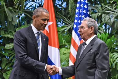 "Carlos Fernandez de Cossio, Havana's top diplomat in charge of relations with Washington, recalls the ""emotional moment"" and hope in Cuba after US President Barack Obama (L) and his Cuban counterpart Raul Castro (R), agreed to revive diplomatic ties"