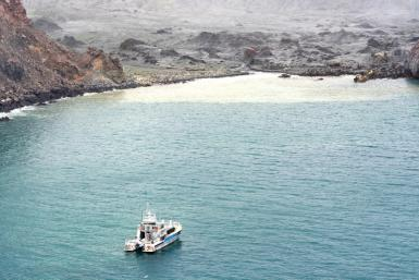 Divers searching the contaminated waters around New Zealand's volcanic White Island on Saturday failed to locate one body seen floating in the area several days ago