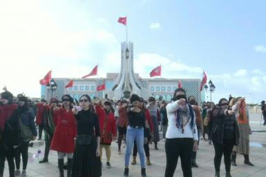 """IMAGES Tunisian women of the Falgatna collective perform in Arabic the Chilean viral feminist anthem turned into a mighty global roar against sexual violence """"The Rapist is You!"""" during a flashmob in Tunis."""