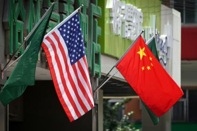 The US (L) and Chinese flags (R) displayed outside a hotel in Beijing