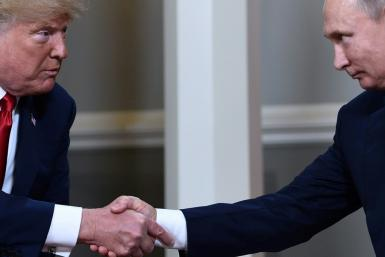 US President Donald Trump (L, pictured July 2018) has frustrated US intelligence services by refusing to heed them, often listening to rivals like Russian President Vladimir Putin instead