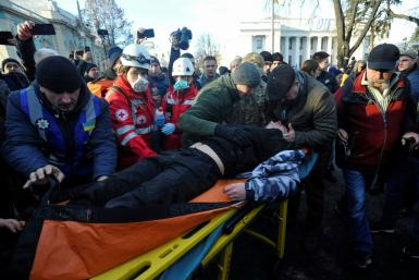 An injured protester receiving aid