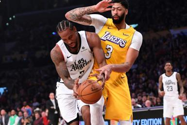 Kawhi Leonard of the Los Angeles Clippers (L) is fouled by the Lakers' Anthony Davis in the Clippers' 111-106 NBA victory over the Lakers