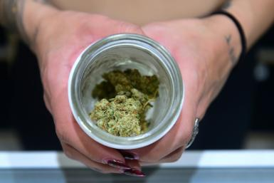 A jar of Insane OG, a strain of marijuana, at the opening of 'Dr. Greenthumb,' a medical and recreational marijuana dispensary in Sylmar, California