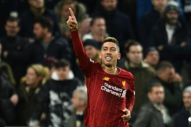Liverpool's Roberto Firmino celebrates scoring against Tottenham