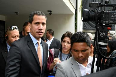 Lawmakers supporting Venezuelan opposition leader and self-proclaimed acting president Juan Guaido (C) say that pro-government loyalists opened fire at them