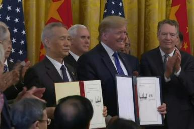 """US President Donald Trump and China's Vice Premier Liu He sign """"phase one"""" of a new partial trade agreement"""