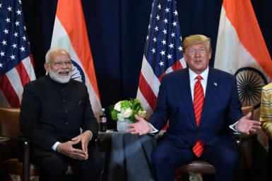 US President Donald Trump, seen here with Indian Prime Minister Narendra Modi, did not know that India shared a border with China, according to a new book